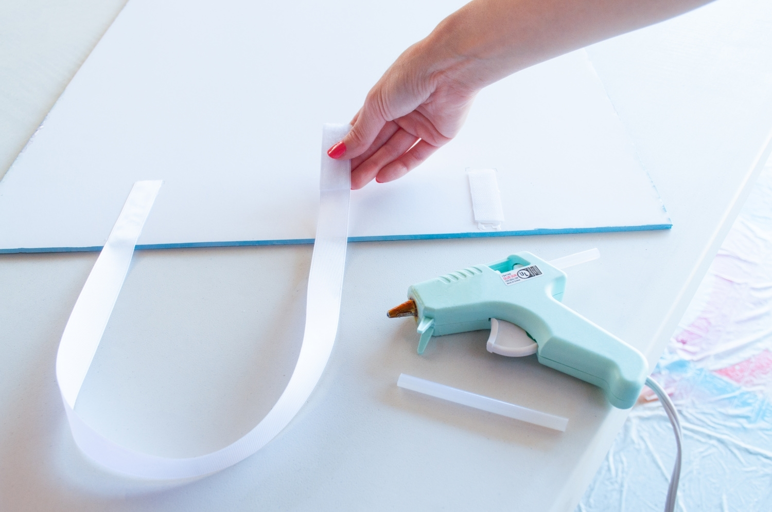 Glue ribbon to back of paint chip costume
