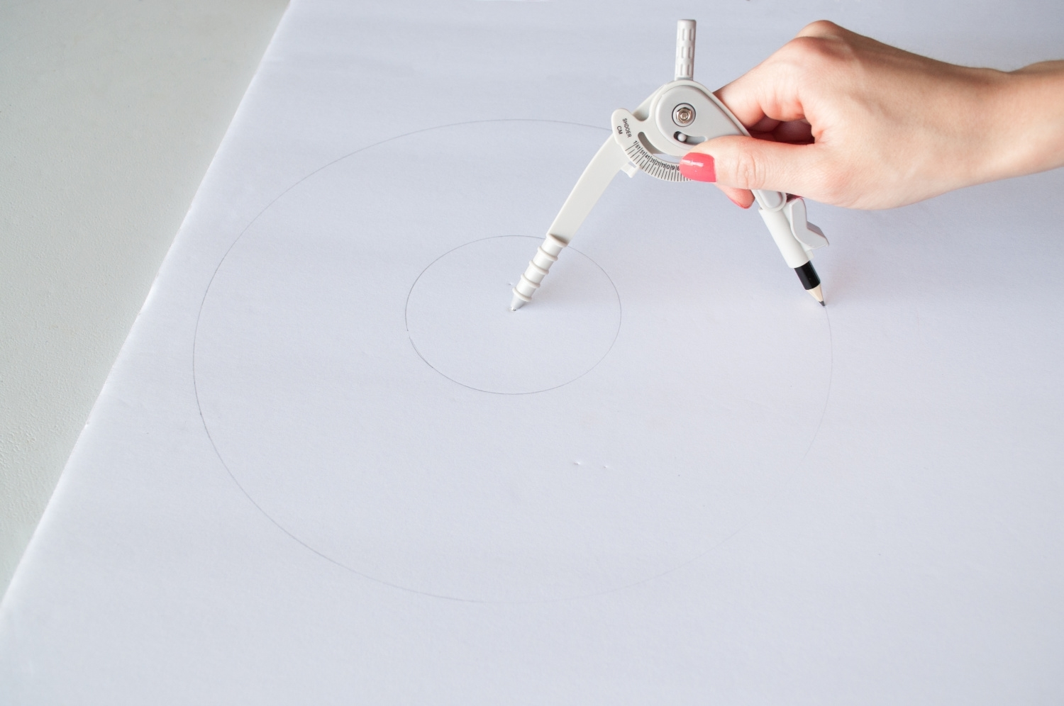 Use compass to create circles on foam board