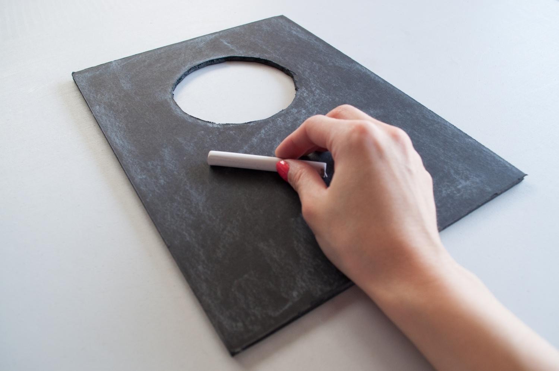 Cut foam board to fit dog and create chalkboard effect
