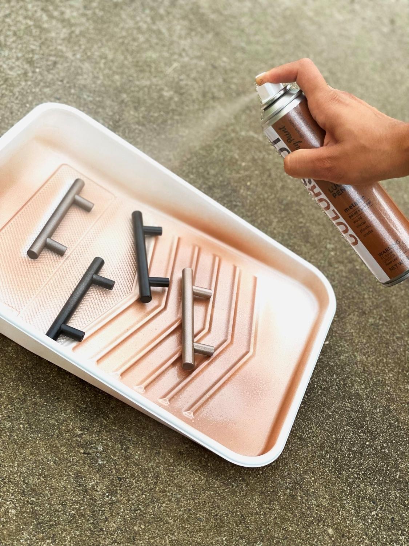 Apply light coats of spray paint to hardware