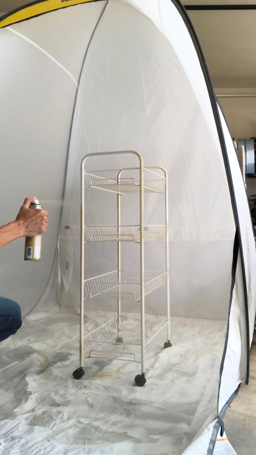 Spray paint your cart using several light coats